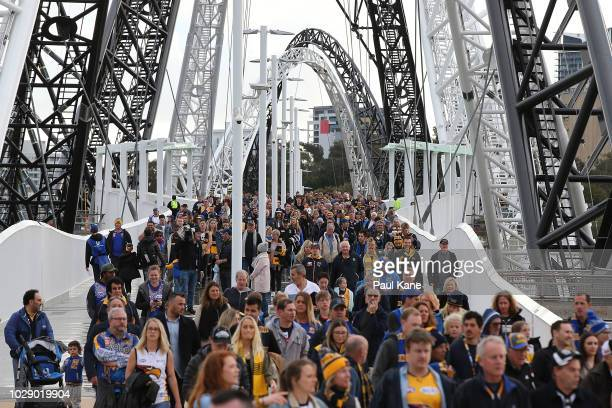 Spectators arrive before the AFL Second Qualifying Final match between the West Coast Eagles and the Collingwood Magpies at Optus Stadium on...