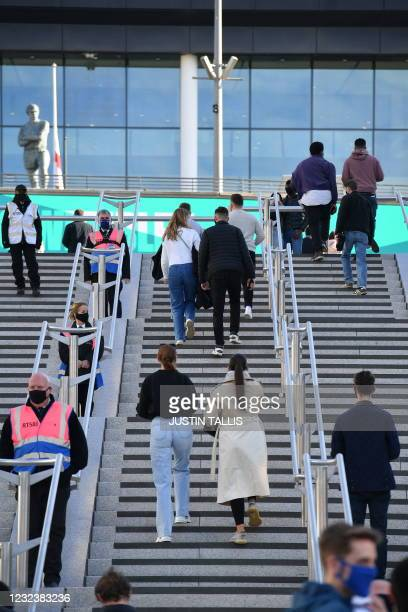Spectators arrive to attend the English FA Cup semi-final football match between Leicester City and Southampton at Wembley Stadium in north west...