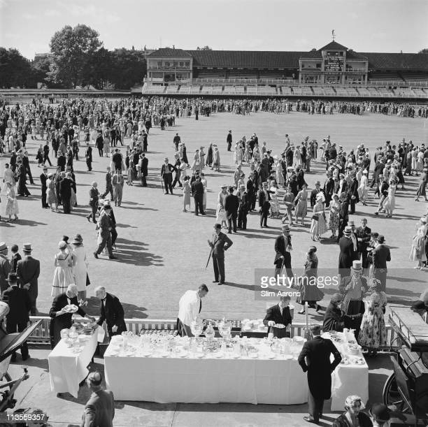 Spectators at a cricket match between the public schools of Eton and Harrow at Lord's Cricket Ground London 1955