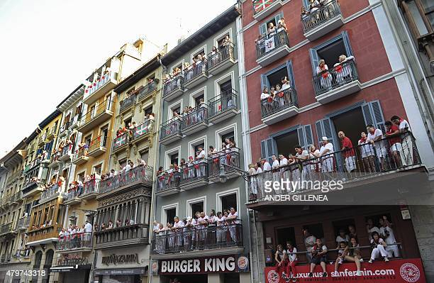 Spectators at balconies wait for the start of the first 'encierro' of the San Fermin Festival in Pamplona northern Spain on July 7 2015 The festival...