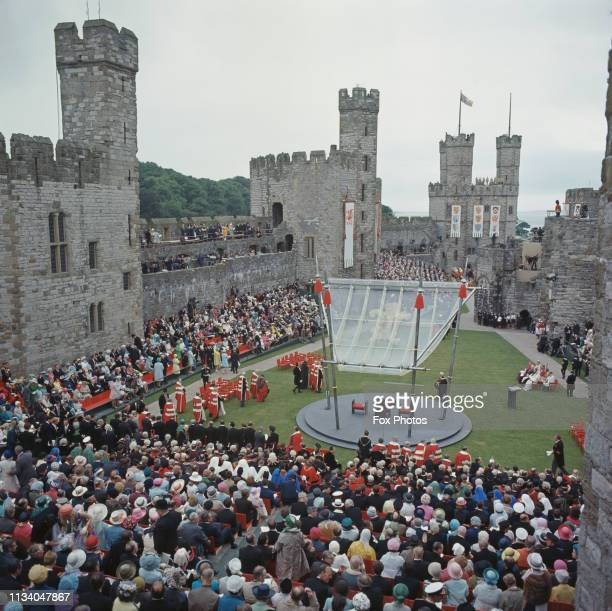 Spectators at Caernarfon Castle during the ceremony of investiture of Prince Charles as Prince of Wales, Gwynedd, Wales, 1st July 1969. At centre is...