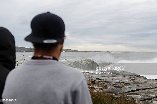 Spectators at Cape Fear on June 6 2016 in Sydney Australia The wave breaks into Botany Bay just a few hundred metres from the site of James Cooks...