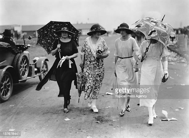 Spectators at Epsom Downs Racecourse, Surrey, June 1922.