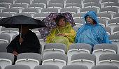 london england spectators at lords rain