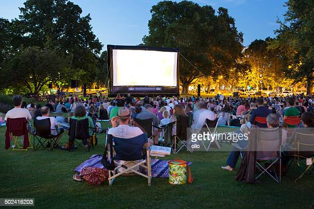 spectators at open-air cinema - outdoors stock pictures, royalty-free photos & images