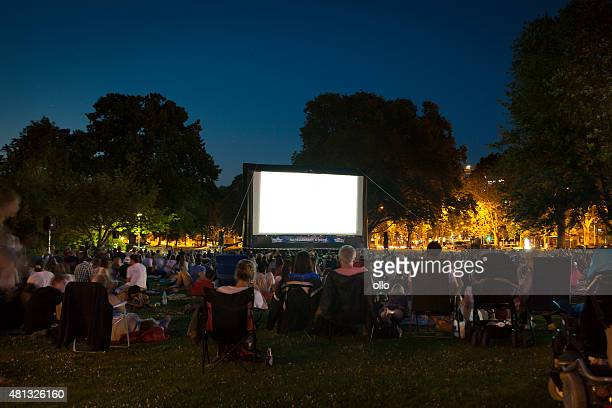 Spectators at Open-Air cinema summer night