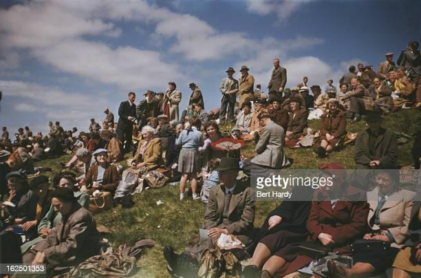 Spectators at the Epsom Derby at Epsom Downs in Surrey, 2nd June 1954. Original publication: Picture Post - Derby - unpub
