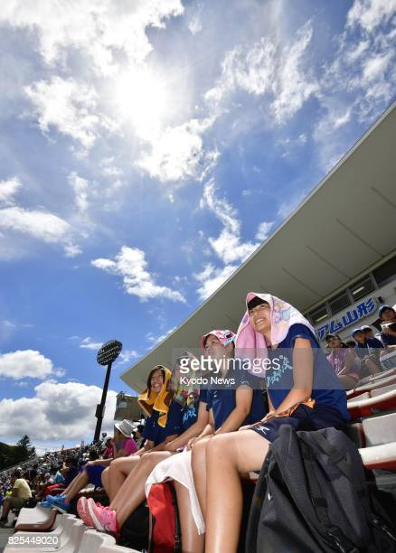 Spectators at the high school track and field competition broil under the sun in the northeastern Japan city of Tendo on Aug 2 2017 The rainy season...