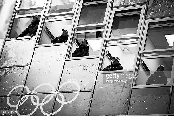 Spectators at the Ladies' Normal Hill Individual first round on day 4 of the Sochi 2014 Winter Olympics at the RusSki Gorki Ski Jumping Center on...