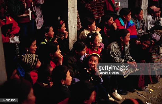 spectators at the mani rimdu festival at chiwang gompa (monastery). - mani rimdu festival stock pictures, royalty-free photos & images