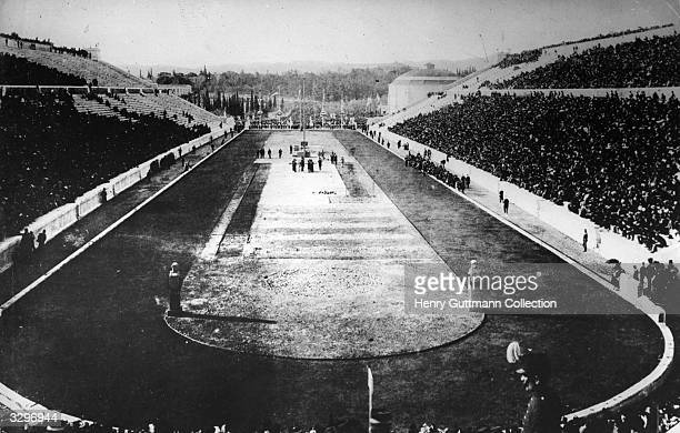 Spectators at the Olympic stadium in Athens, for the 1896 Games. The first modern Olympics initiated by Pierre de Coubertin who was inspired by the...