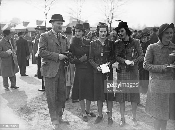 Spectators at the spring race meeting at Newbury Racecourse Berkshire 31st March 1939 Left to right Edward Digby 11th Baron Digby Osla Benning Miss G...