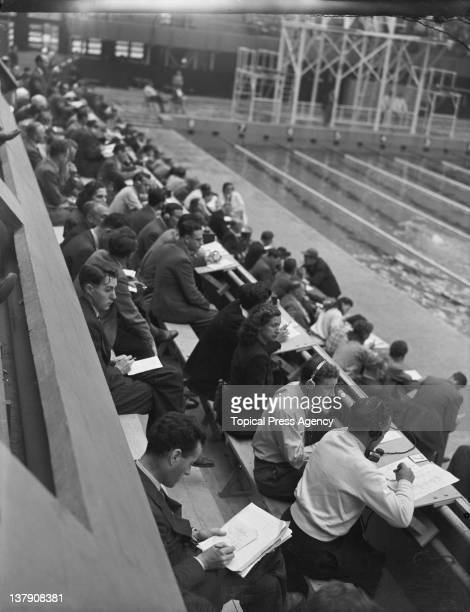 Spectators at the women's 100 metre backstroke event at the Empire Pool Wembley during the London Olympic Games August 1948