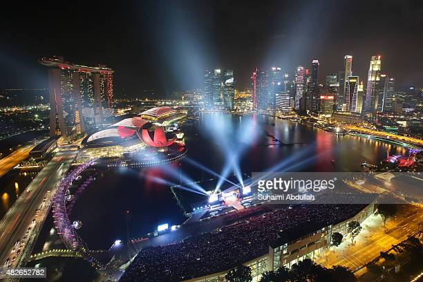 Spectators attend the National Day Parade preview at the floating platform at Marina Bay on August 1, 2015 in Singapore. Singapore will be...