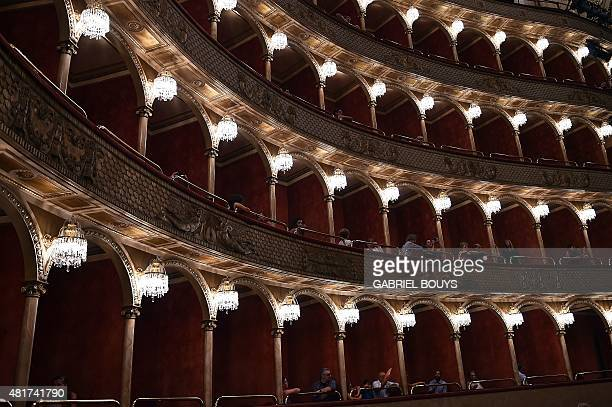 Spectators attend the premiere of the show 'Golgota' at the Teatro dell'Opera in Rome on July 23 2015 The show combines equestrian art music and...