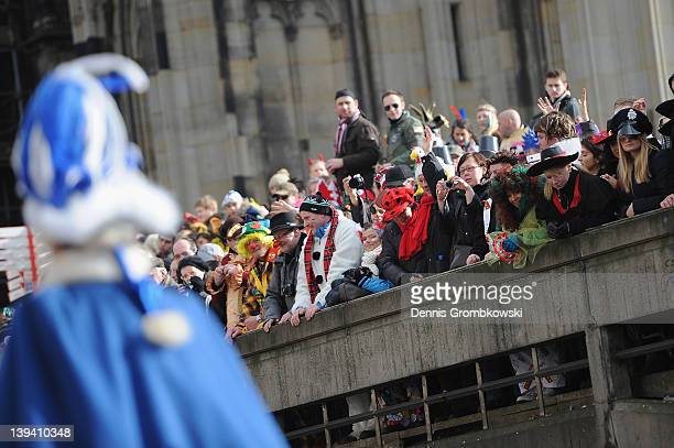 Spectators attend the Rose Monday parade on February 20 2012 in Cologne Germany Rose Monday is the highpoint of the Carnival season which...