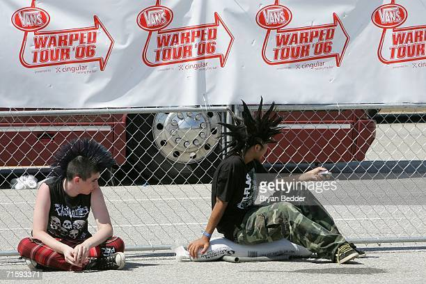 Spectators attend the Vans Warped Tour on August 5 2006 in Uniondale New York