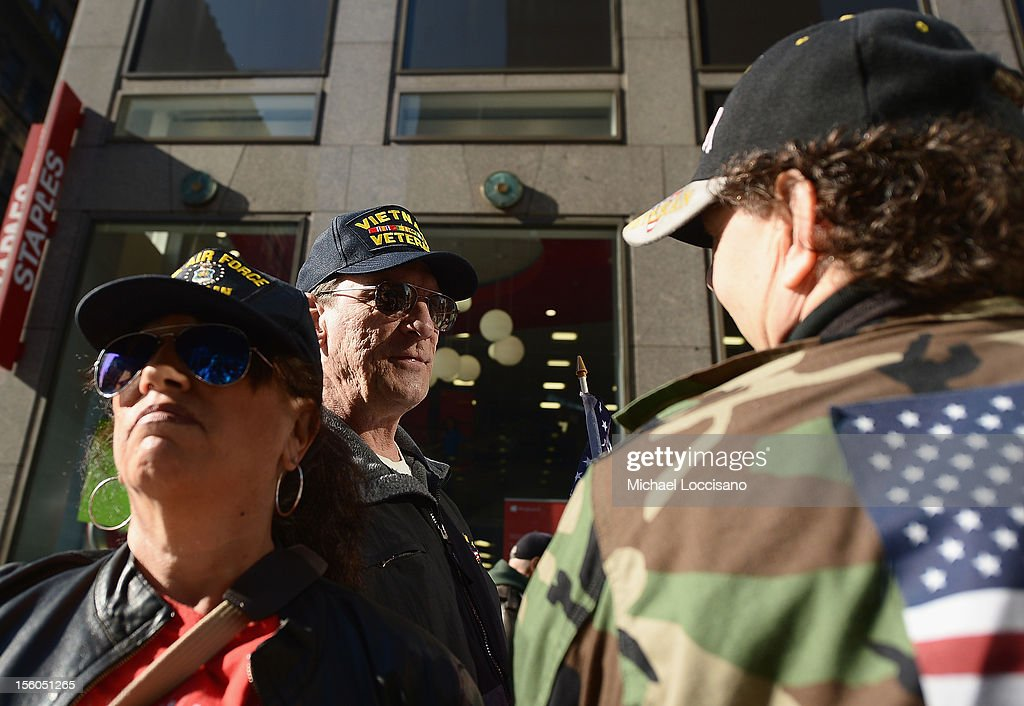 Spectators attend the Veteran's Day Parade on November 11, 2012 in New York City. Former Mayor Ed Koch is the grand marshal for the parade, which expects to draw thousands of spectators and is the commemoration of the 50th anniversary of the start of the Vietnam War.