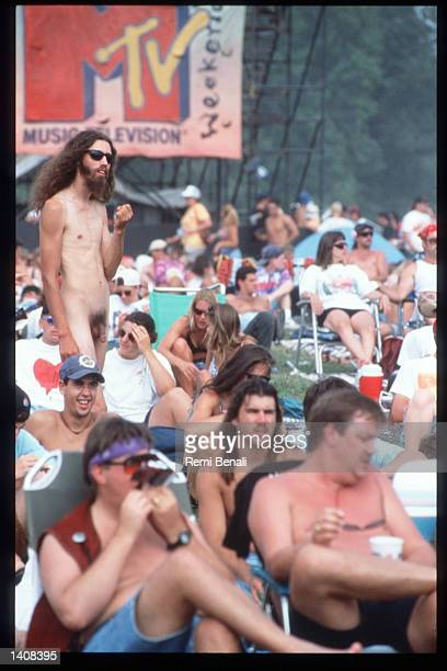 Spectators attend the Woodstock 25th anniversary concert August 13 1994 at Winston Farm in Saugerties NY An international media event that helped...