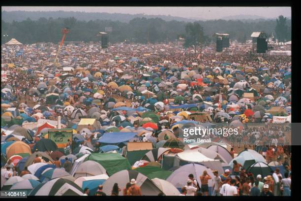 Spectators attend the Woodstock 25th anniversary concert August 13, 1994 at Winston Farm in Saugerties, NY. An international media event that helped...