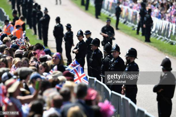 Spectators await Prince Harry Duke of Sussex and Meghan Duchess of Sussex as they leave Windsor Castle in the Ascot Landau carriage during a...