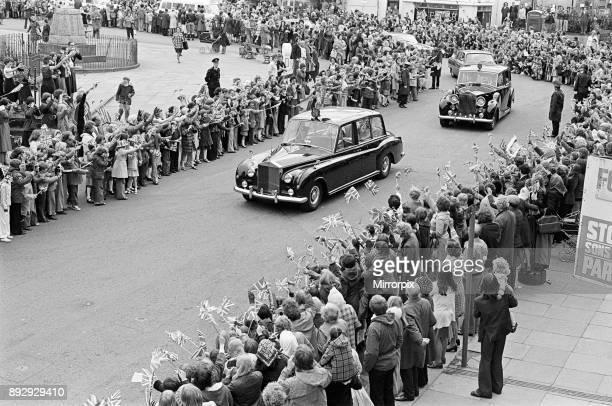 Spectators await Queen Elizabeth II and Prince Philip Duke of Edinburgh in Eston during the Silver Jubilee tour 14th July 1977