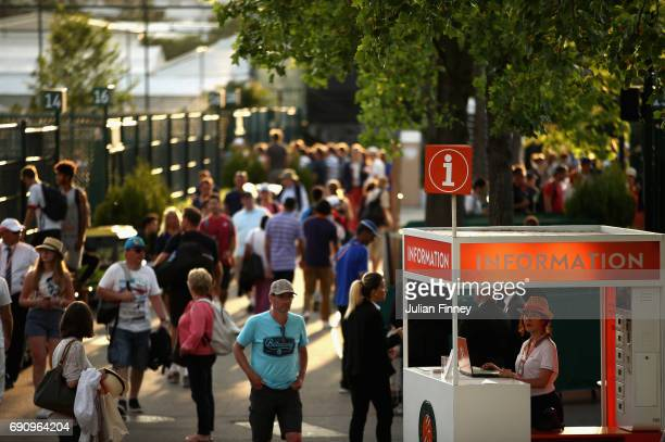 Spectators begin to leave the grounds on day four of the 2017 French Open at Roland Garros on May 31 2017 in Paris France