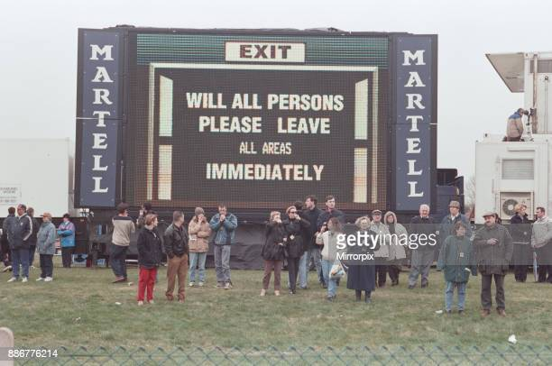 Spectators being evacuated from the course after an IRA bomb threat at the 1997 Grand National Aintree near Liverpool 5th April 1997