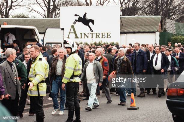 Spectators being evacuated from the racecourse after an IRA bomb threat at the 1997 Grand National Aintree near Liverpool 5th April 1997
