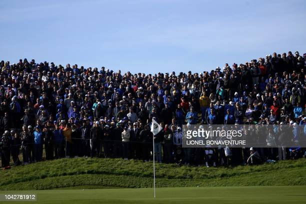 Spectators beside a green on the second day of the 42nd Ryder Cup at Le Golf National Course at SaintQuentinenYvelines southwest of Paris on...