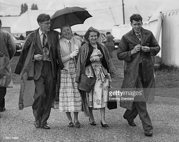 Spectators brave the rain at the Henley Royal Regatta HenleyOnThames England 29th June 1955