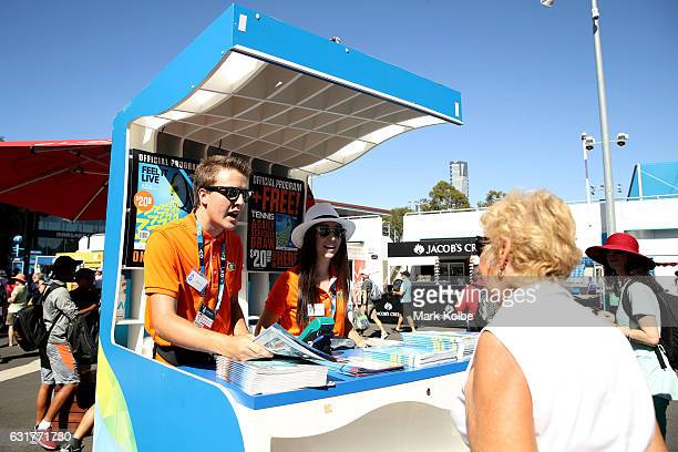 Spectators buy an official Australian Open program on day one of the 2017 Australian Open at Melbourne Park on January 16 2017 in Melbourne Australia