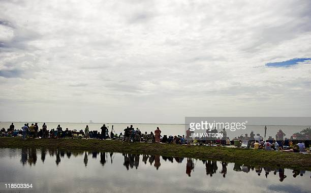 Spectators camp out at a park in Titusville, Florida, as the space shuttle Atlantis prepares for launch from Kennedy Space Center on July 8, 2011 for...