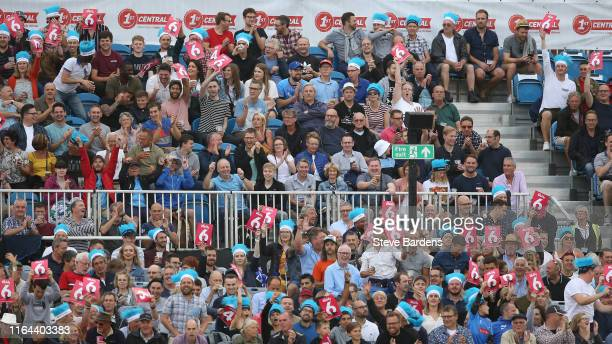Spectators celebrate a six during the Vitality Blast match between Sussex Sharks and Surrey at The 1st Central County Ground on July 26, 2019 in...