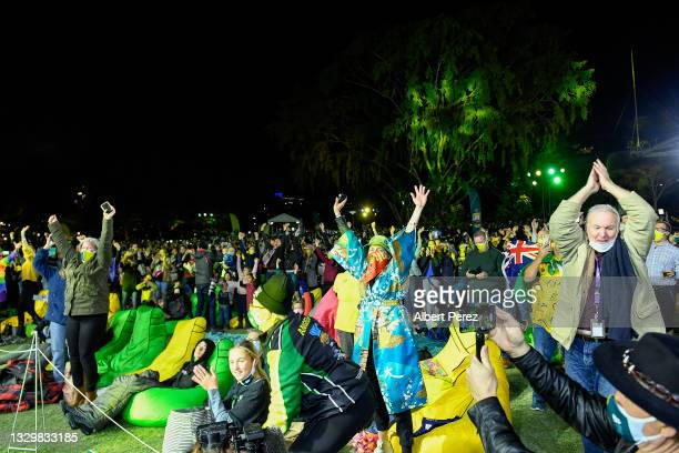 Spectators celebrate after Brisbane was announced the host of the 2032 Olympics during the announcement of the host city for the 2032 Olympic Games,...