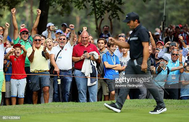 Spectators celebrate after Francesco Molinari holes an eagle putt on the 1st hole during the fourth round of the Italian Open at Golf Club Milano...