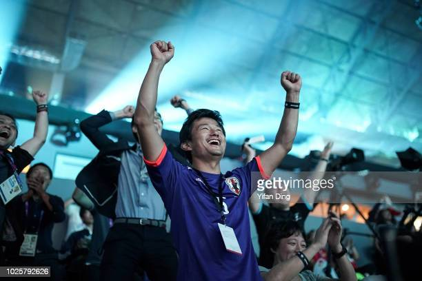 Spectators celebrate after Team Japan score a goal during Asian Games Esports Demonstration Event Pro Evolution Soccer Final between Japan and Iran...