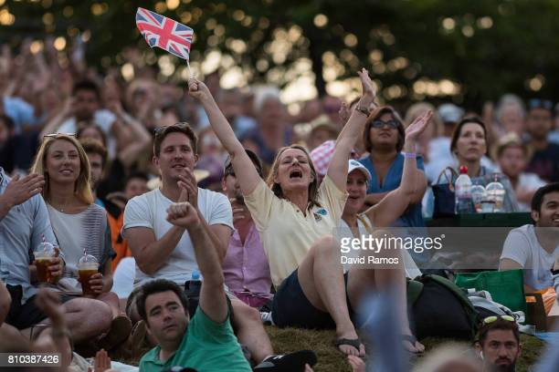 Spectators celebrate Andy Murray's victory over Fabio Fognini during their Gentlemen's Singles second round match from 'Murray Mound' on day five of...