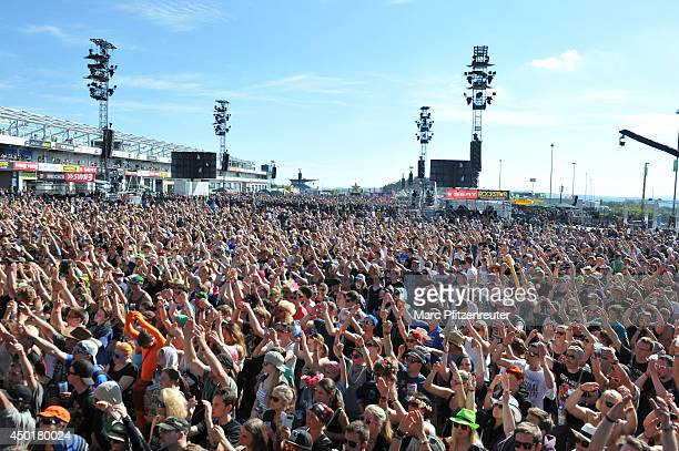 Spectators celebrate in front of the centerstage during the second day of 'Rock am Ring' on June 06 2014 in Nuerburg Germany