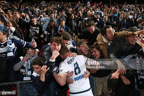 Spectators celebrate with Besart Berisha of the Victory after the round three ALeague match between Adelaide United and Melbourne Victory at Coopers...