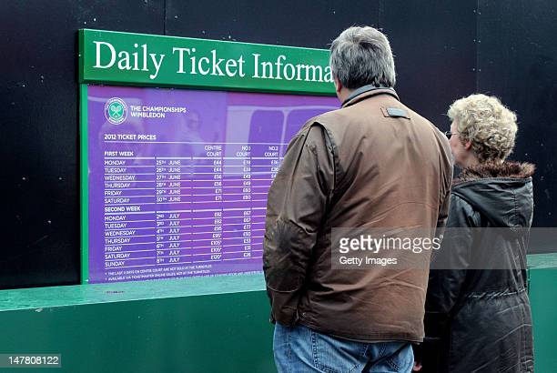 Spectators check ticket prices on day eight of the Wimbledon Lawn Tennis Championships at the All England Lawn Tennis and Croquet Club on July 3 2012...