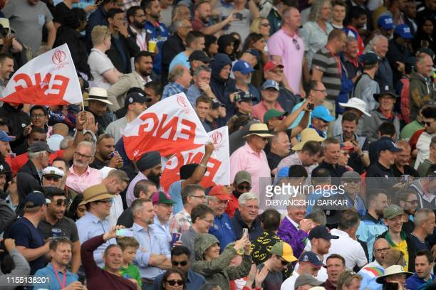 Spectators cheer after the 2019 Cricket World Cup second semifinal between England and Australia at Edgbaston in Birmingham central England on July...