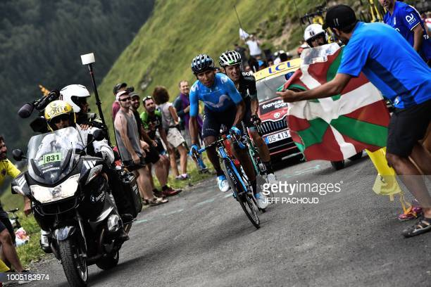 Spectators cheer as Colombia's Nairo Quintana and Poland's Rafal Majka ride during a twomen breakaway in Portet pass of the 17th stage of the 105th...
