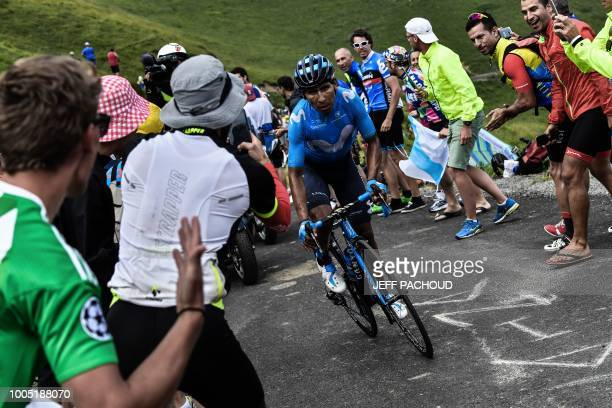 Spectators cheer as Colombia's Nairo Quintana rides during a oneman breakaway in the Portet pass of the 17th stage of the 105th edition of the Tour...