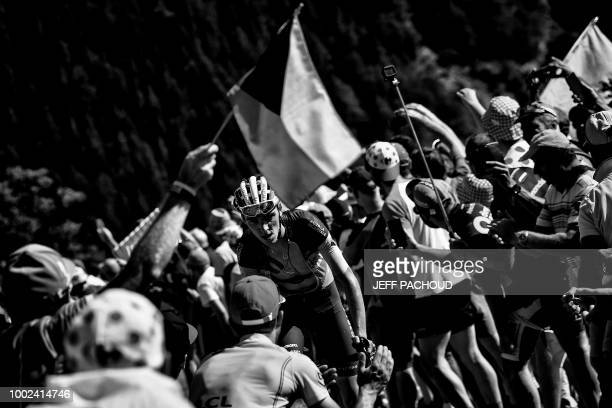 Spectators cheer as France's Romain Bardet rides in the ascent to l'Alpe d'Huez during the twelfth stage of the 105th edition of the Tour de France...