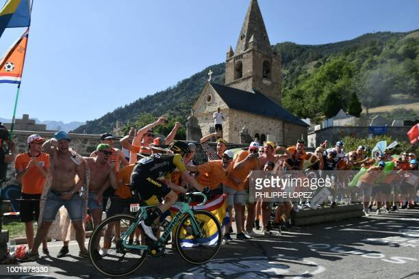 Spectators cheer as Netherlands' Steven Kruijswijk rides through the socalled 'Dutch Corner' in the ascent to l'Alpe d'Huez during the twelfth stage...