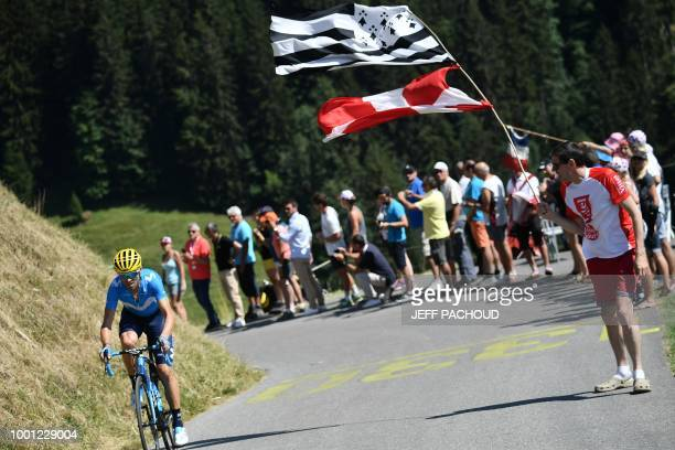 Spectators cheer as Spain's Alejandro Valverde rides in the last ascent during a counter attck in the eleventh stage of the 105th edition of the Tour...