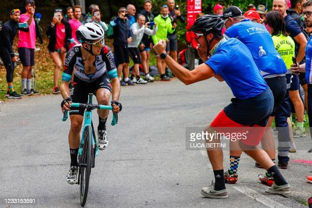 Spectators cheer as Team BikeExchange rider Great Britain's Simon Yates rides in the final ascent on his way to win the 19th stage of the Giro...