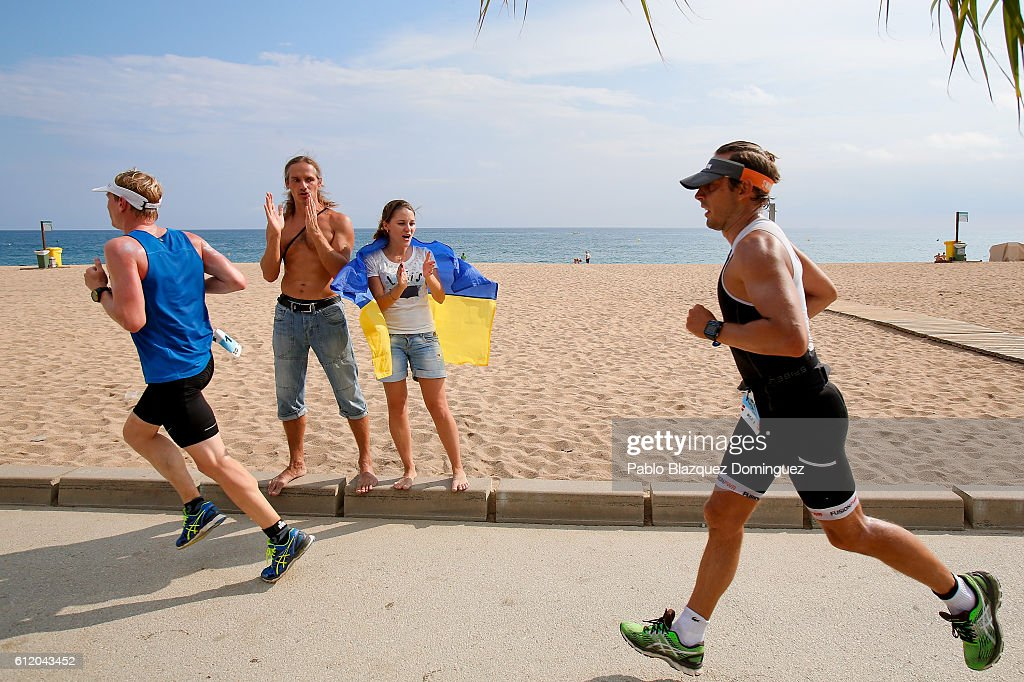 Spectators cheer at athletes competing during the run leg of Ironman Barcelona on October 2, 2016 near Calella, in Barcelona province, Spain.