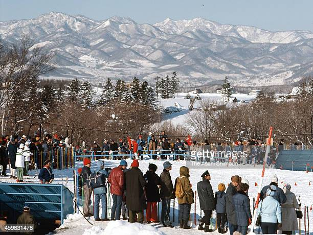 Spectators cheer athletes at the Cross Country Skiing Men's 15km during the 1972 Sapporo Winter Olympics at Nishioka Cross Country Course on February...